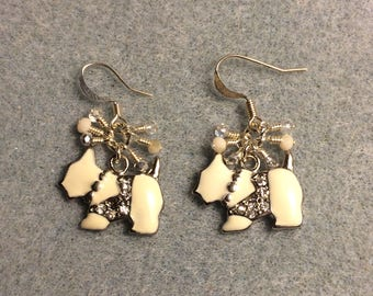White enamel and rhinestone Scottish terrier charm earrings adorned with tiny dangling white, silver, and clear Chinese crystal beads.