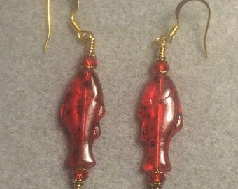 Red with black spots Czech glass fish bead dangle earrings adorned with red Chinese crystal beads.