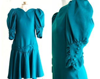 1980s teal prom dress with dropped waist and bow detail