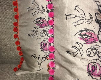 "Pink and orage floral 18"" scatter cushions with pom pom trim"