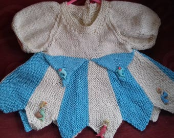 Hand knitted dress knitted to fit a baby girl aged 0-3 months old