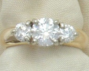 Diamond engagement ring featuring 1/2ct. center diamond with 2  -.33ct side diamonds in 18k shank