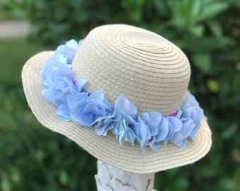 Cream summer sun hats, with blue flowers