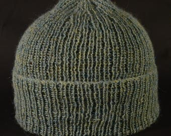 interesting tweed effect,in this pure alpaca,rival to cashmere,it has blue highlights against a mossy green,