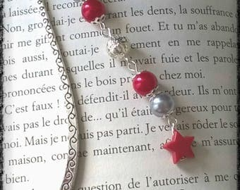 Bookmark made of red and grey pearls and a star silver metal