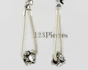 Metal earrings with Pearl with crystals on snake chain doubled and small two-color Crystal bicones