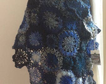 wrap-scarf-shawl- Circles are crocheted in all kinds of blue tones