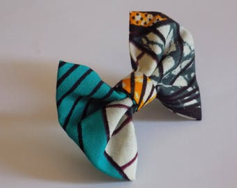 Bow in yellow, blue, Burgundy, gray wax ring.