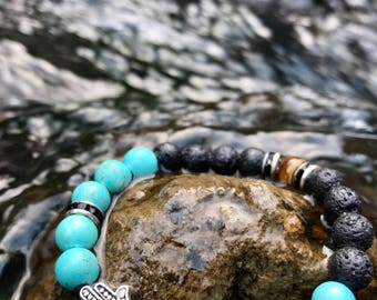 Protection Tigers Eye Hamsa , real Turquoise bracelet. This bracelet will bring its owner happiness, luck, health, and good fortune.