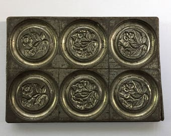 Antique chocolate mold, 1930, Anton Reiche, Dresden, Germany.  Nickel alloy mold to make beautiful round chocolates embossed with flowers.