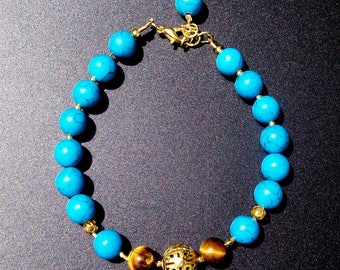 Howlite and Tiger eye (gemstones) bracelet. Gold-plated