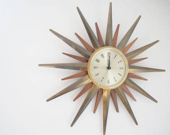 Vintage teak and brass Paico sunburst wall clock