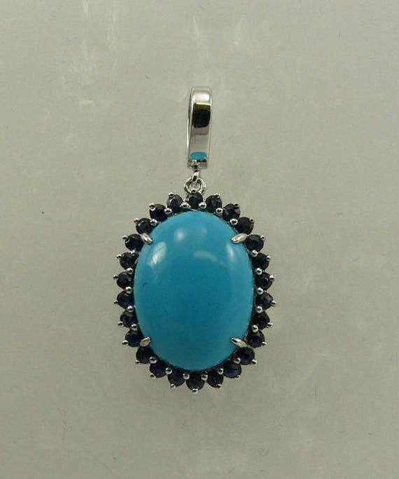 Turquoise Oval Shape and Blue Sapphire Pendant with Sterling Silver Setting