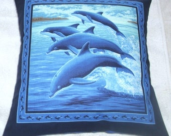 Dolphins leaping through the sea cushion
