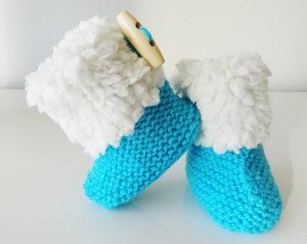 small blue woolen boots filled 1-3 months