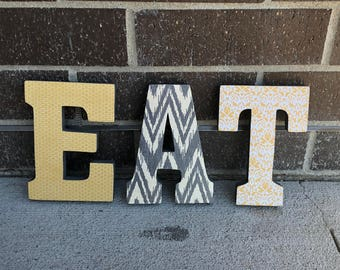 Wooden, stand alone EAT letters