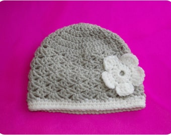 Nice white gift adorned with a border and flower baby Hat gray