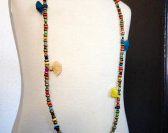 Necklace with multicolored beads, wood and PomPoms