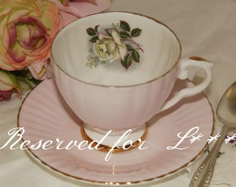 Reserved for L*** Consort: Very light pink tea cup and saucer, with white rose