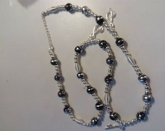 Necklace black silver beads and charms