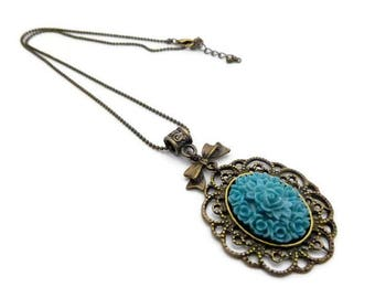 Cabochon resin teal backed filigree necklace