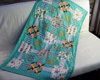 Blanket style quilt Teepee and cactus