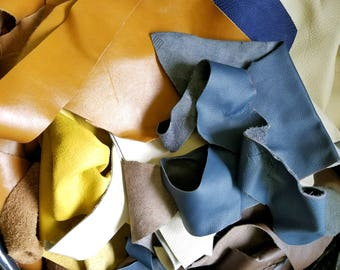 Large cow leather scraps and pieces, miscellaneous sizes and colors. Approximate sizes 50-144 square inches each