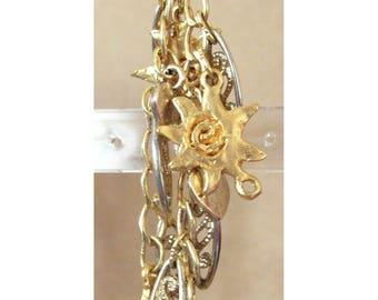 Sun and golden metal filigree pendant