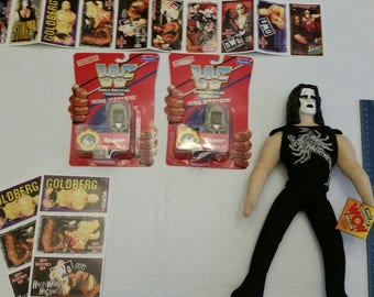 vintage 1990 's pro wrestling collection - wcw sting doll - 30 nwo valentine collectible trading cards - 2 wwf goldust figures by ringmaster