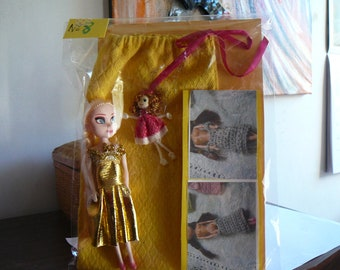 8/small doll and her wardrobe.