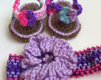 0-3 mos. crocheted baby flip flops with matching headband. Variegated purples, pinks & blues.