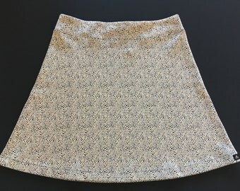 Subtle Black/Ivory Print Activewear/Officewear Skirt Soft Stretchy Fabric with Hidden Adjustable Tie Comfortable A-Line Cut Skims over Hips