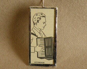Accordion Player- Handmade Soldered Glass Pendant with Black and White Vintage Dictionary Illustration