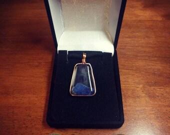 Amethyst and lapis lazuli resin pendant.