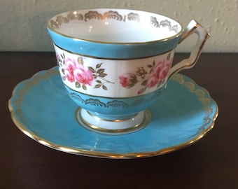 Beautiful Aynsley Turquoise and Rose Tea Cup with Saucer