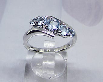 Women's size 58 ring silver and Blue Topaz