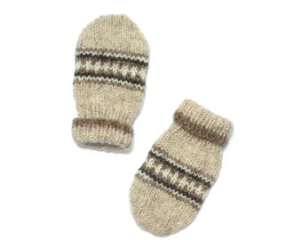 Baby mitts 0 - 6 months.