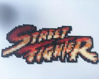 Street Fighter logo display. Hama bead pixel creation.