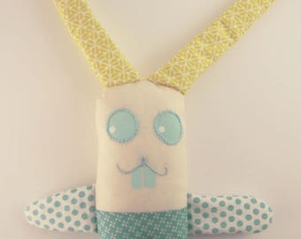 Bunny ears in cream, green and mustard yellow colors