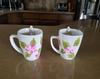 Hand painted mugs with pink flowers. Includes matching spoons. set of 2