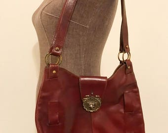 Vintage leather Etienne Aigner in Oxblood color with brass or goldtoned hardware!