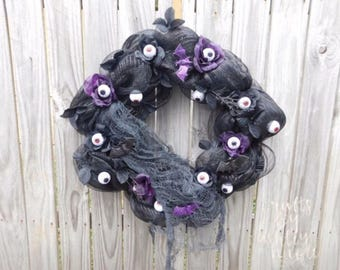 Black Haunted Eye Wreath
