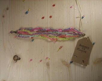 Six multi-colored yarn Beads Bracelet