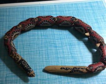 Vintage wooden toy snake