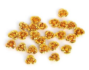20 Golden aluminum flower separately: 6 mm beads