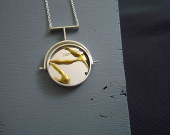 Well/Unwell. Spinning pendant set with kintsugi mirror on one side, and is broken on the other shows the delicate path to recovery