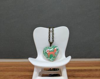 Love heart red fox locket on an 80cm bronze chain.