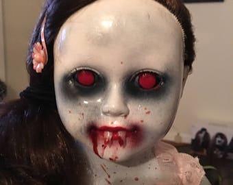 Creepy vampire doll