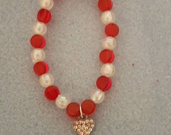 Red and white beaded bracelet with silver diamante heart