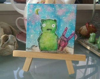 Kuchi kopi glow in the dark watercolor painting (2x2) with stand
